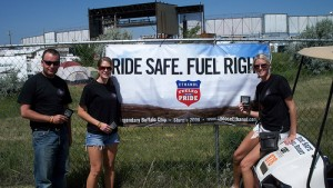 The Market Development Team of the Renewable Fuels Association stands near one of their banners during the 2009 Sturgis Rally at the Legendary Buffalo Chip Campground, just East of Sturgis, SD. www.ChooseEthanol.com